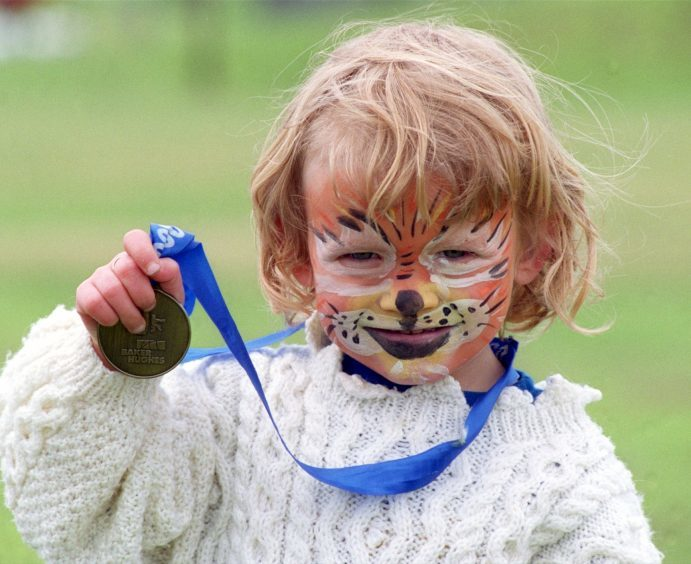 Four-year-old Caitlin Fyfe of Portlethen after her 1K fun run at the 10K Baker Hughes race at the Beach last year.