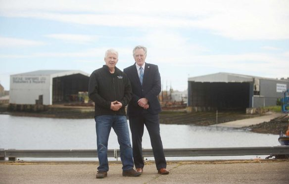 Macduff Shipyards managing director John Watt and Moray Council's economic development committee chairman John Cowe in front of the newly-purchased shipyard.
