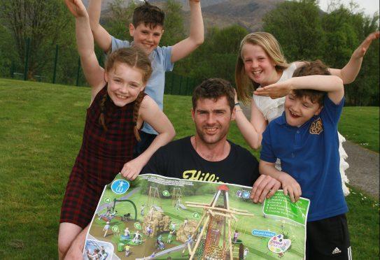 Damian MacDonald with Daisy MacDonald, Ewan MacDonald, Faith Easson and Zander MacDonald celebrate the news of a new playing field in Caol.