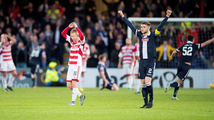 Contrasting emotions for Hamilton's Ali Crawford and Ross County's Marcus Fraser (right) as the home side score a late winner