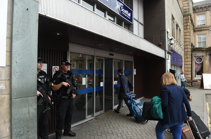 Armed police stand guard at Inverness train station (Picture by Sandy McCook)