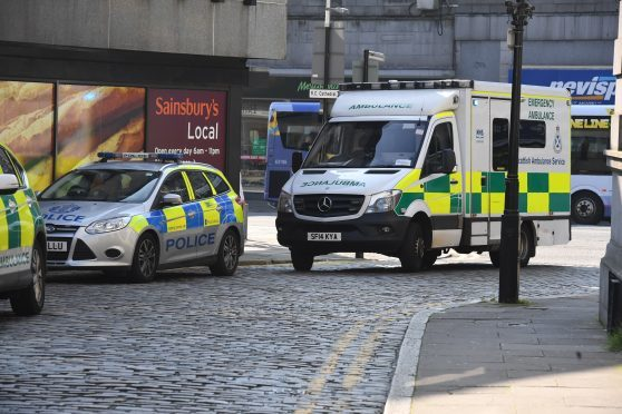 Police attend the scene near Union Street and Huntly Street in Aberdeen.
