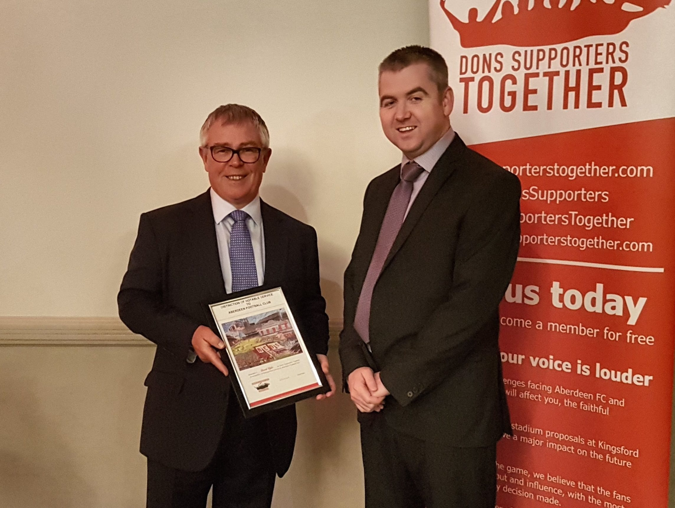 David Wylie (left) receives the awards from DST Chairman, Kevin Mackenzie (right) at the Stand Free Youth Development dinner