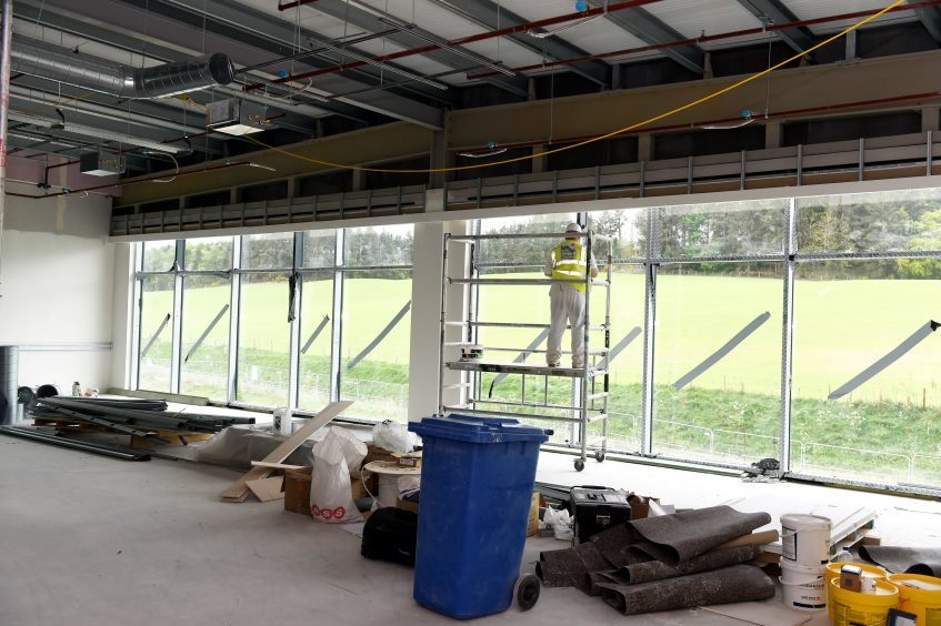 Finishing touches to the windows in a classroom.