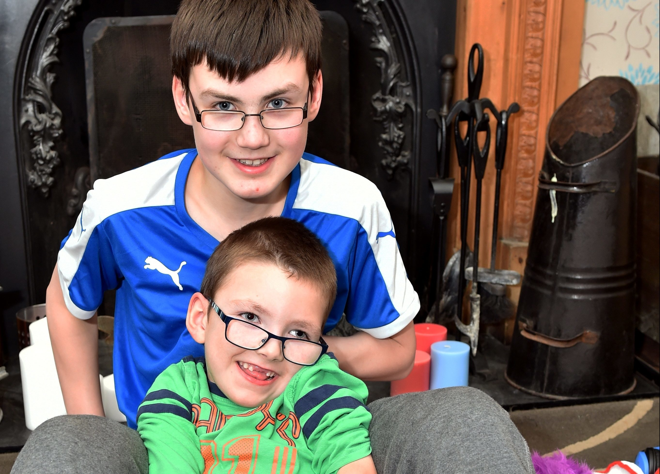 Seven-year-old Aiden Matheson with his older brother James, 13. Pictures by Colin Rennie.