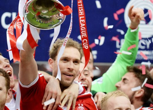 The then Aberdeen captain Russell Anderson lifts the Scottish League Cup trophy in 2014