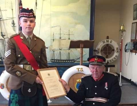 Sergeant Shawn Feeney receiving his Lord Lieutenant's Cadet Certificate from Donald Cameron of Lochiel the Lord Lieutenant of Inverness