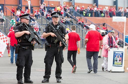 Armed police stand guard outside Hampden