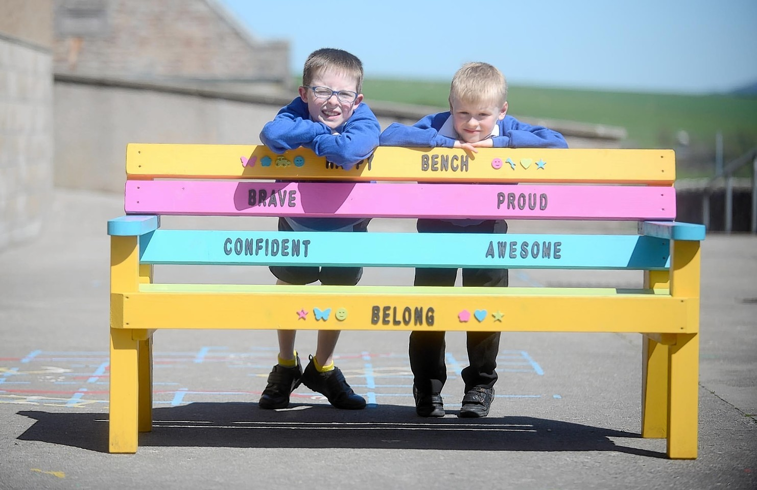 Craig Dick (left) and Max Haywood with the 'happy bench'