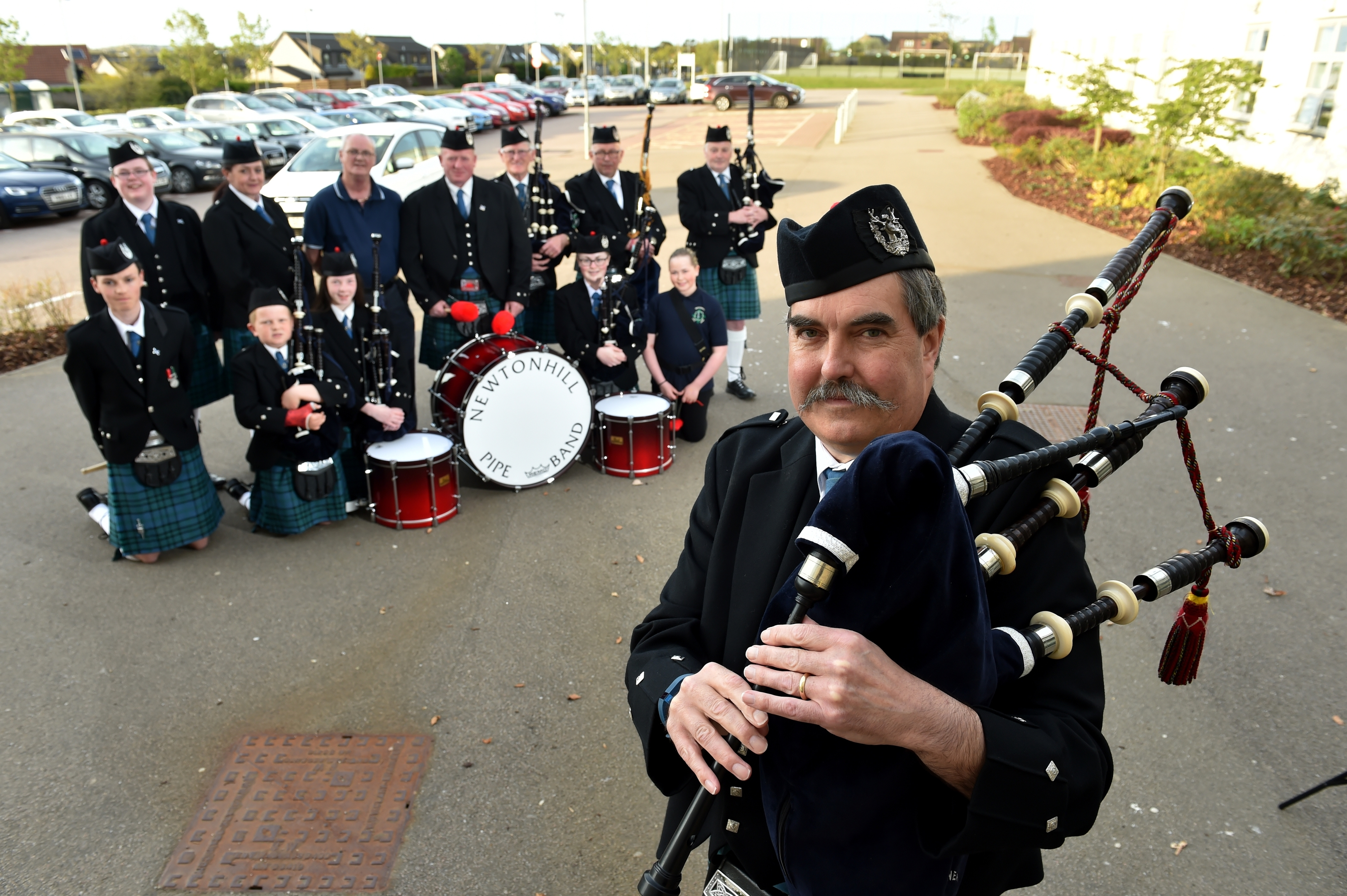 Domhnull Mclennan and some of the pipe band. Picture by Kenny Elrick.