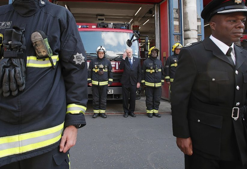 Labour leader Jeremy Corbyn (third right back) joins fire fighters at Islington Fire Station, north London, as he observes a minute's silence to remember the victims of the Manchester terror attack