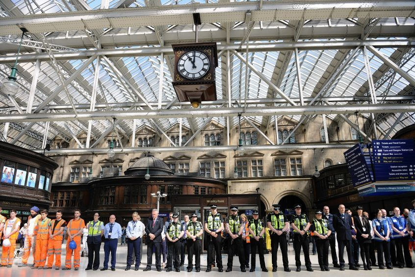 Travellers and staff hold a minute's silence at Glasgow Central Station