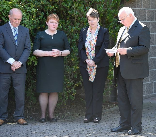 Councillor Bill Lobban leads the minutes silence at Highland Council headquarters in Inverness. Pic by Sandy McCook