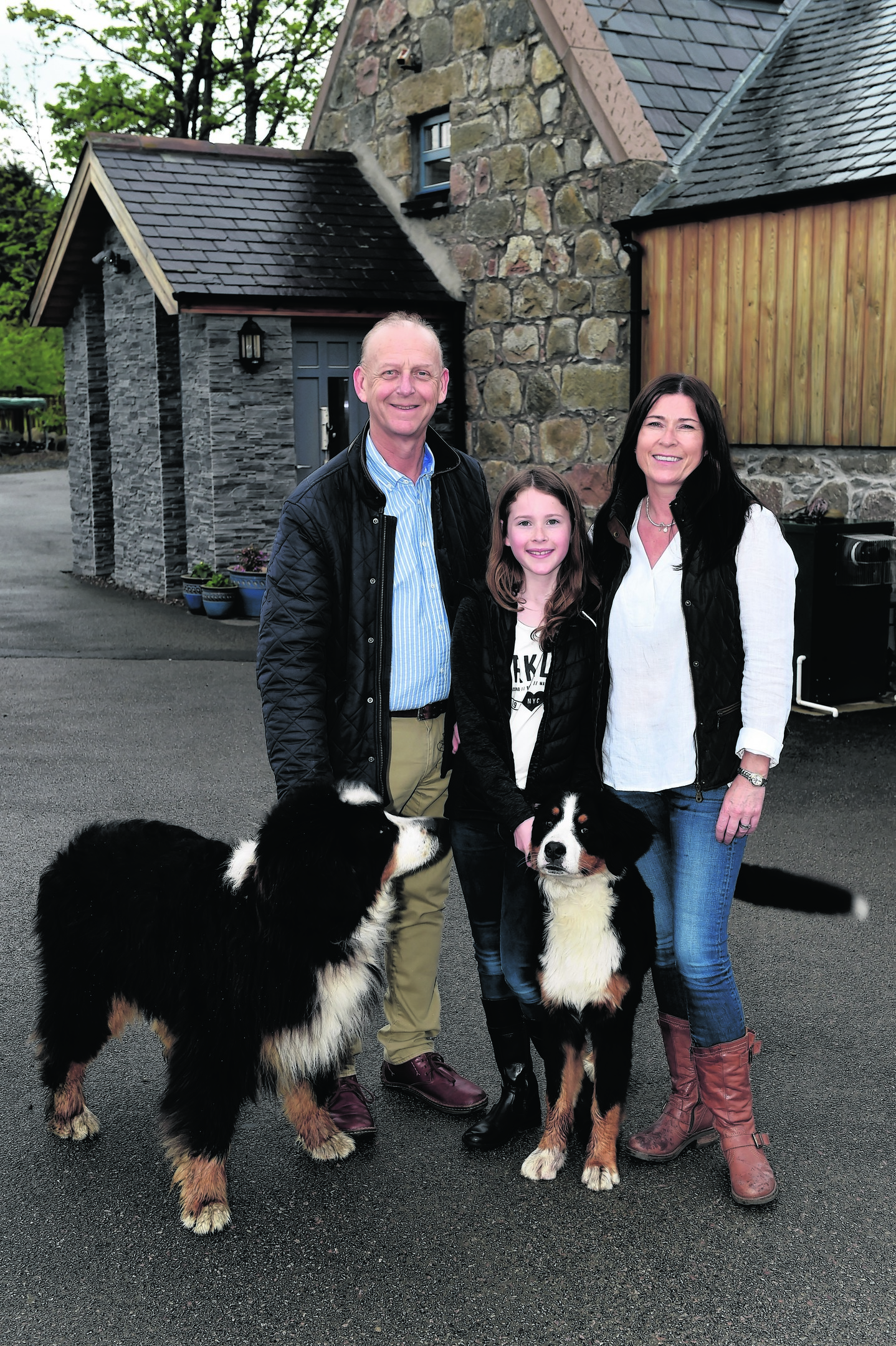 Tina and Steve Roberts and daughter Katie, 11, with their dogs, Suki and Sasha. Picture by KENNY ELRICK     23/05/2017