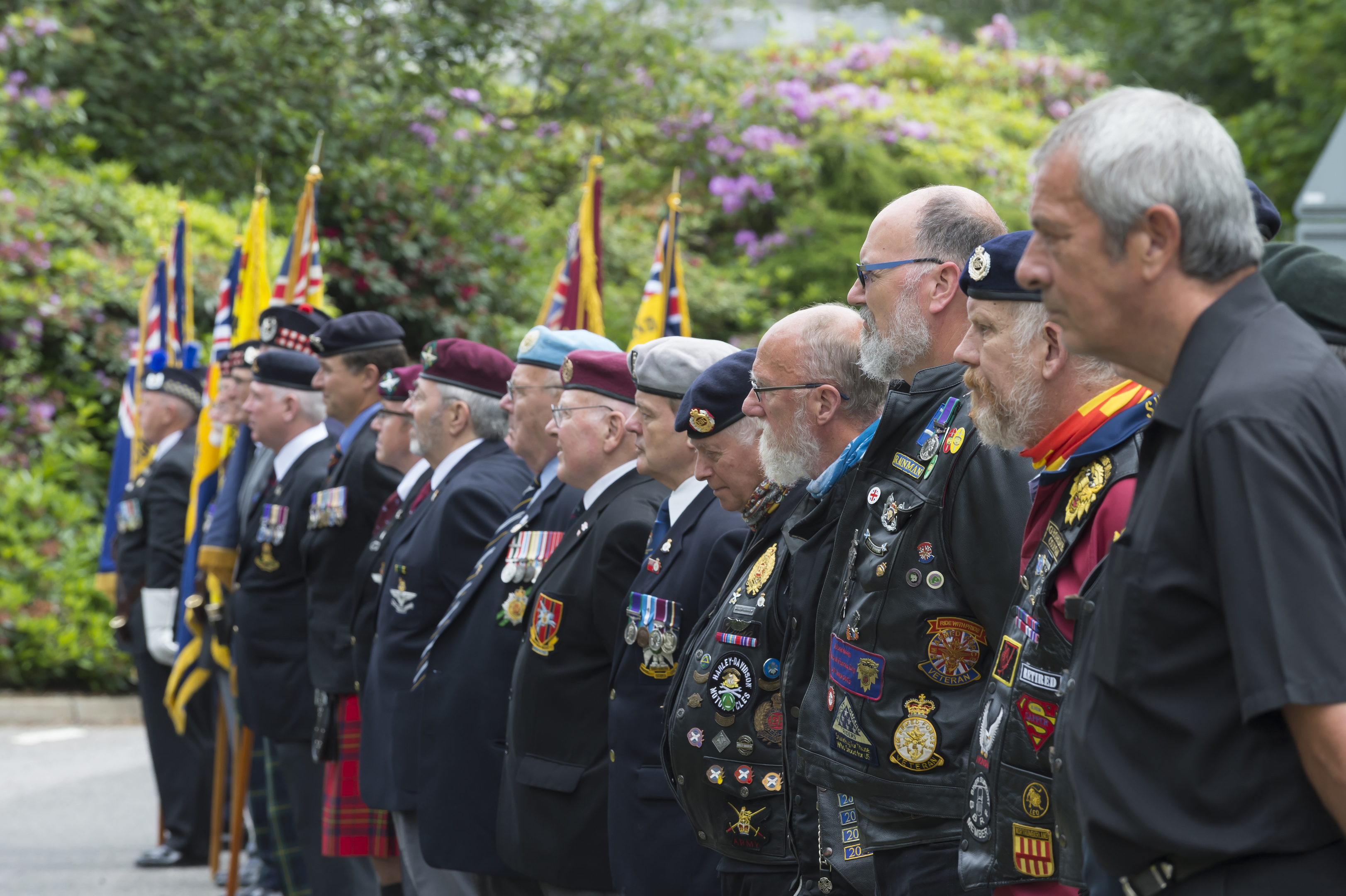 Veterans look on as Lord Provost Bill Howatson raises the Armed Forces Day flag at Aberdeenshire Council's HQ in Aberdeen  in 2017