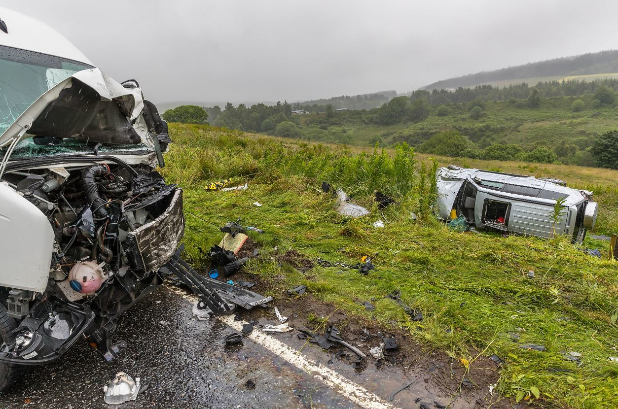 The Mitsubishi 4x4 rolled down an embankment after colliding with a Volkswagen van.