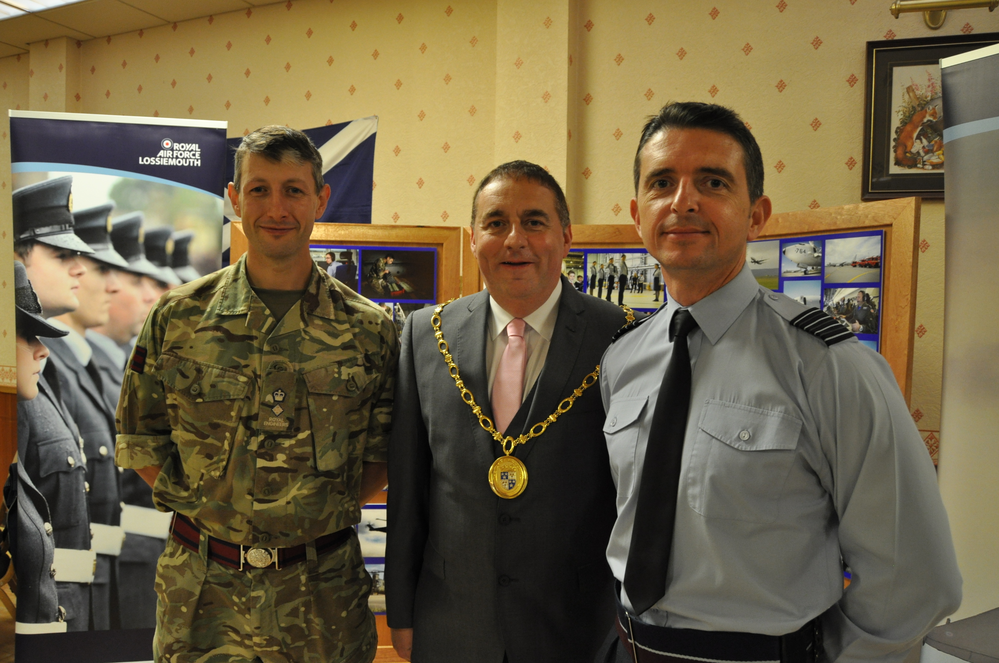 Moray Council convener James Allan with Lt Col Jim Webster of 39 Engineer at Kinloss Barracks, left, and Gp Cpt Paul Godfrey, base commander at RAF Lossiemouth, right.
