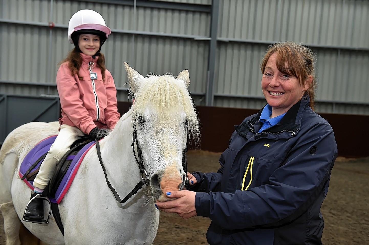 Aberdeen Riding Club manager Sally McCarthy with nine-year-old Abigail Gray.