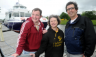 Loch Ness 'swimmers' James O'Donnell (left) of Cantraybridge College and his Maintenance Enabler Jon Lane (right) with Katie Gibb , Community Fund Raiser with Highland Hospice before their sail on Loch Ness yesterday afternoon
