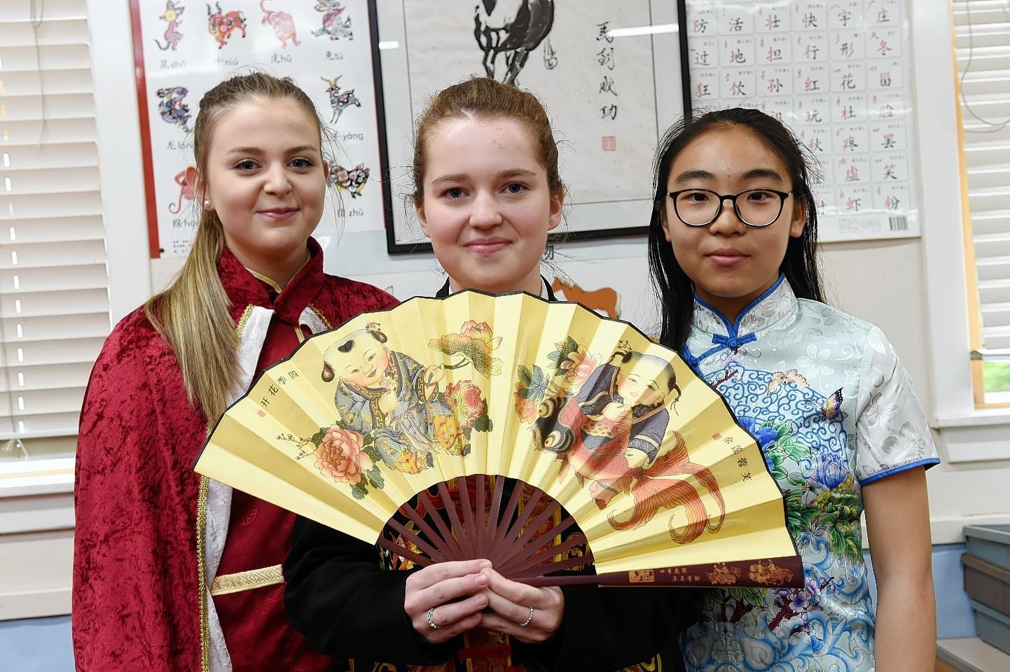 (L-R) Rachel Reid, 16, Chloe Meenan, 16, Bonny He, 14. Picture by Kenny Elrick.