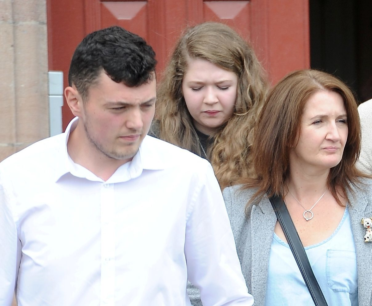 David White leaves Inverness Sheriff Court following sentencing accompanied by Debbie Gillam