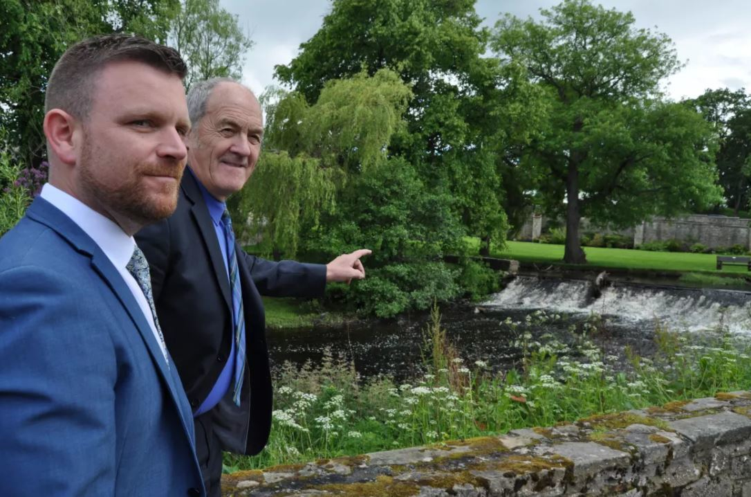 Moray Council leader George Alexander, pictured right, with Gordon Brailsford, owner of the Mosset Tavern, by the side of the Mosset Burn