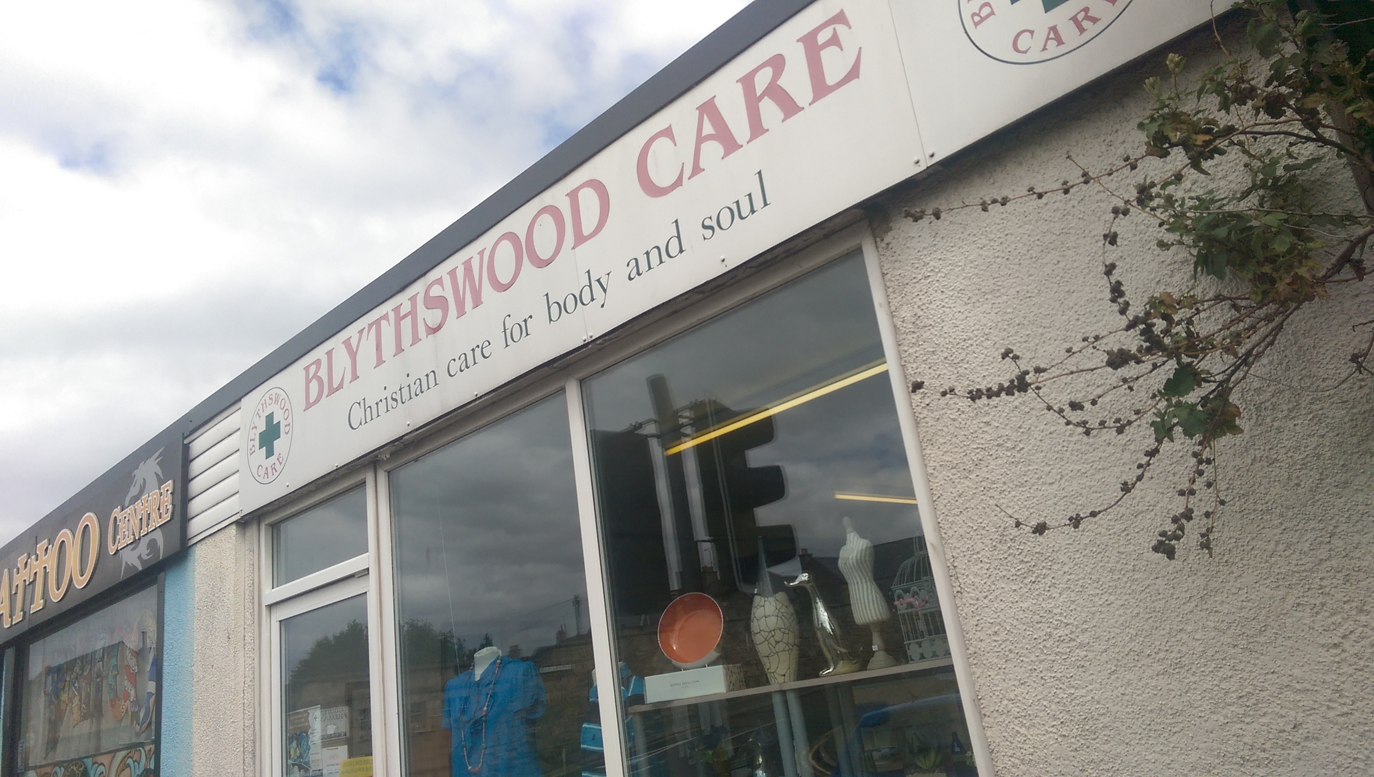 A charity tin containing about £20 was stolen during a break-in at Blythswood Care charity shop.