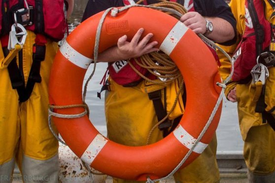 A member of Peterhead's lifeboat crew was suspended temporarily.