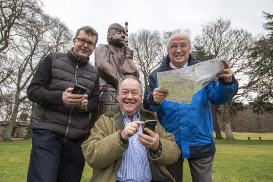 App developer David Sim, Paul Johnson who helped collate the app info and Forres Events director Eddie Tomkinson.