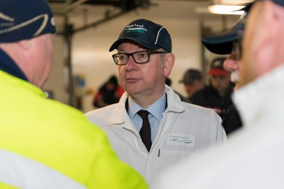 Michael Gove at Peterhead fish market
