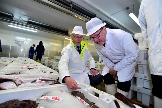 Peterhead Harbour CEO Ian Laidlaw with Scottish Secretary David Mundell at Peterhead fish market in June 2017.