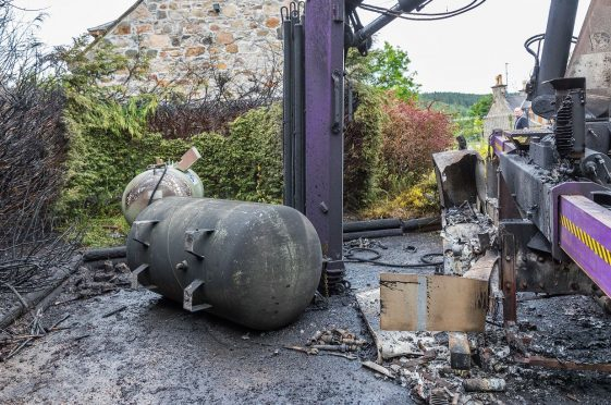 Fire crews warned the damage could have spread to 200 metres if the gas tanks had exploded.