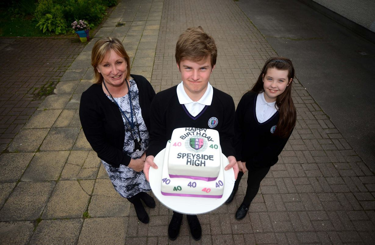 Speyside High celebrated its 40th birthday with a series of fun events for the kids and community. Pictured: Patricia Goodbrand, head teacher, George Sansom, 14, and Leonna Squibb, 12.