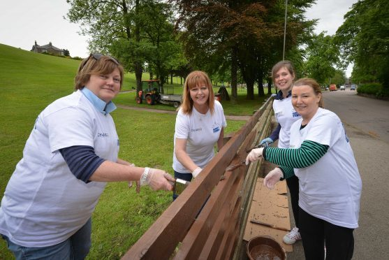 Chivas Brothers staff Linda Brown, Caroline Mitchell, Ashley Brown, Yvonne Thackeray got to work painting a new fence.