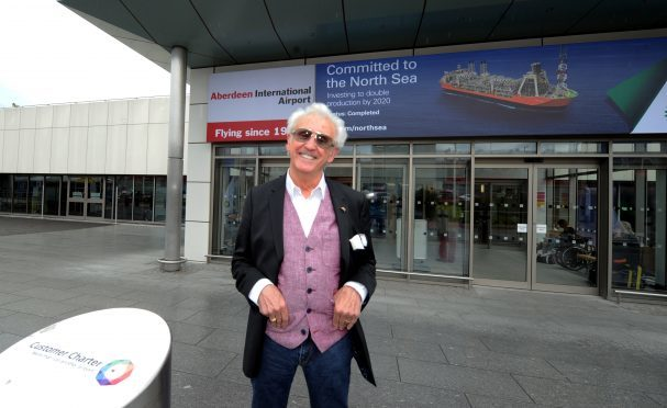 Singer, Tony Christie arrives off a Flybe flight from Birmingham at Dyce Airport, Aberdeen.  Picture by Jim Irvine