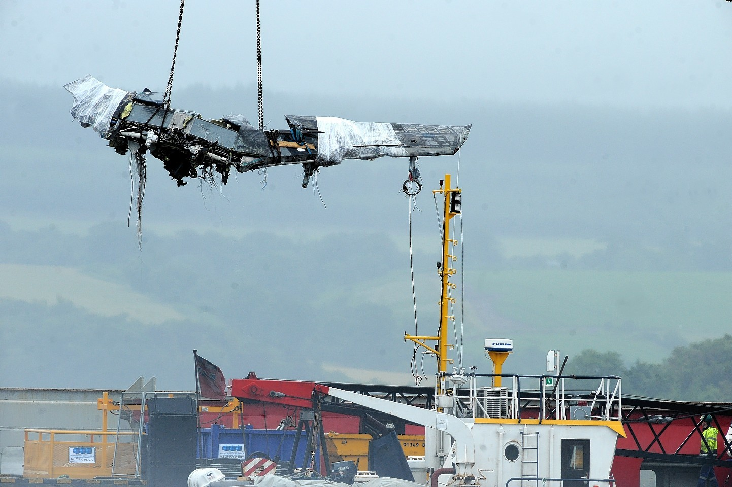 The wreckage of the two crashed RAF Tornados being brought to shore