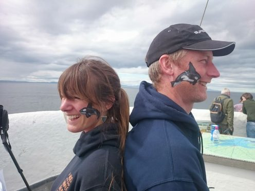 Orca were spotted off the coast during the weekend. Pictured: shorewatch volunteer Katie Dyke, Burghead Headland Trust trustee Steve Truluck.
