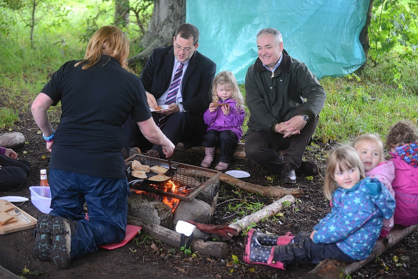 The Scottish Government Minister for Childcare and Early Years, Mark McDonald MSP and Richard Lochhead MSP visit Earthtime Nursery on Duffus Estate it is a nursery based on out side learning.  also in the photo little Orlaith Kessack 3 (centre)  Photo by Michael Traill 9 South Road Rhynie Huntly AB54 4GA  Contact numbers Mob07739 38 4792 Home01464 861425