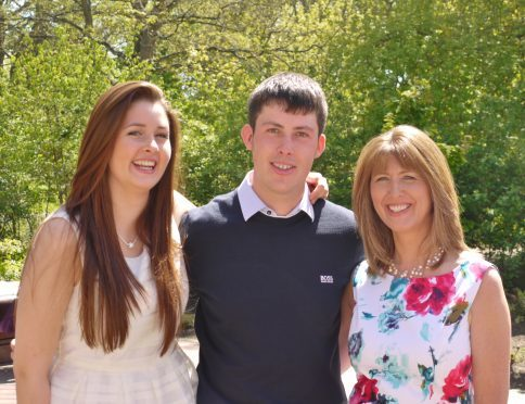 Eileen Buchan (right) pictured with her daughter Sarah, 23, and 26-year-old son Scott.