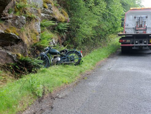 Police and recovery workers at the scene of the crash on the Dores to Foyers road