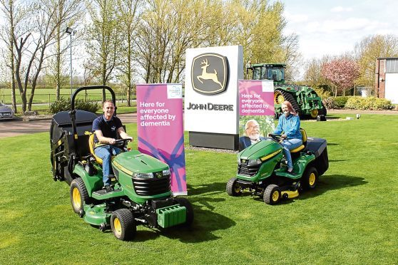 Andy and Kathryn Maxfield are planning to break the Guinness World Record for driving from John O'Groats to Land's End on a lawn tractor, while also raising money for Alzheimer's Society.