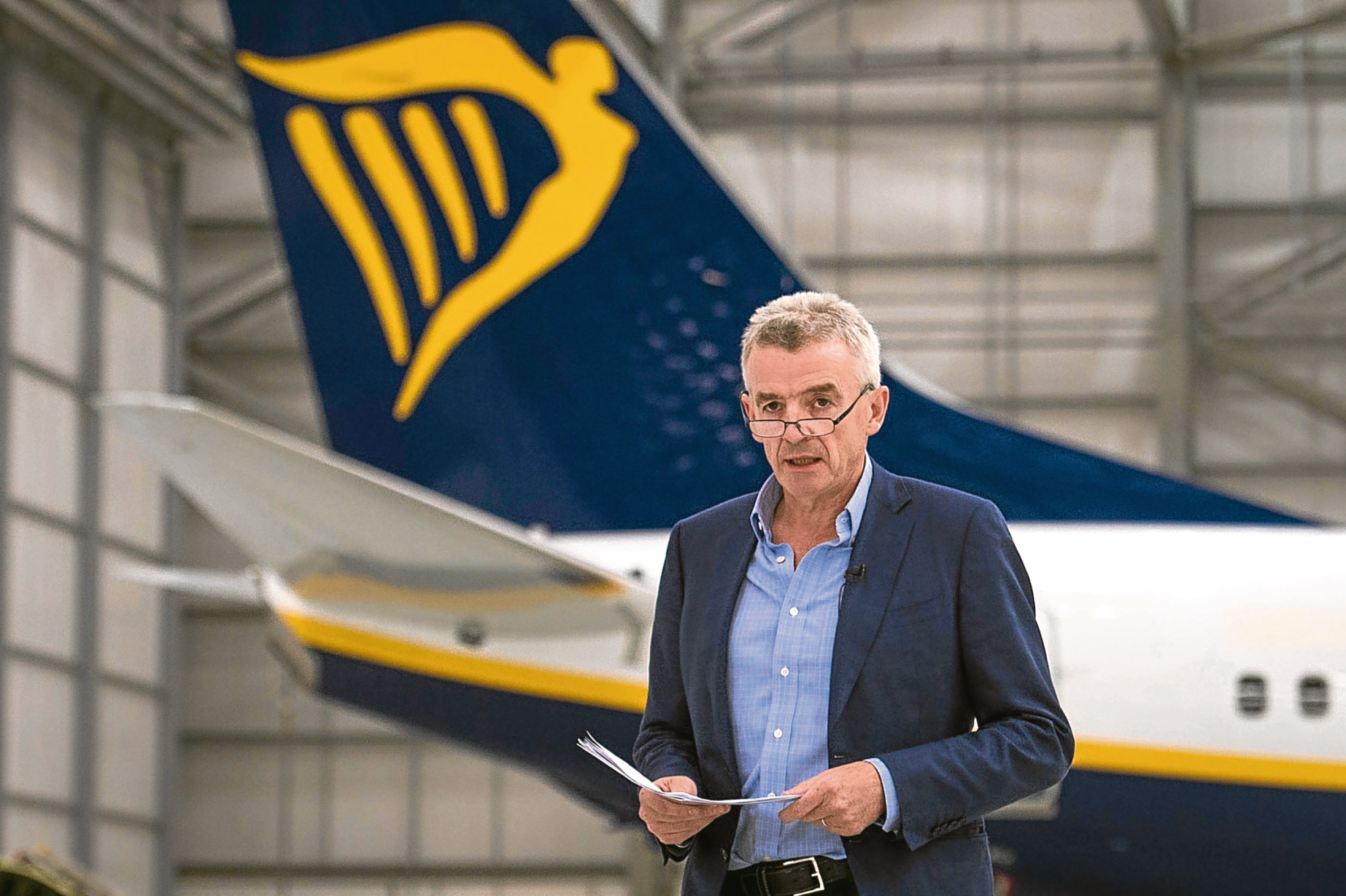 """Ryanair chief executive Michael O'Leary, introduces Chancellor of the Exchequer George Osborne, Ed Balls and Sir Vince Cable, in the Ryanair hangar at Stansted Airport, where the Chancellor said that 450 jobs and almost £1 billion in investment announced by Ryanair would be """"at risk if we left the EU"""". PRESS ASSOCIATION Photo. Picture date: Monday May 16, 2016. The Ryanair boss warned that the budget airline will be forced to scale back British investment if the country votes to leave the European Union. Appearing on a platform with Chancellor George Osborne at Stansted Airport, Mr O'Leary said that inward investment will be lost to competitor EU member states such as Ireland and Germany if Britain votes for Brexit. He also announced the creation of 450 new jobs in Britain as part of a 1.4 billion US dollars (£976 million) investment into the Ryanair's 13 UK bases. See PA story CITY Ryanair EU. Photo credit should read: Stefan Rousseau/PA Wire"""