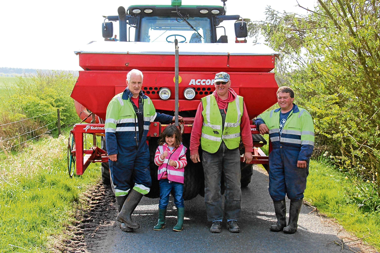 Peter Robertson, his daughter Georgina,the farm's foreman Graham Milne, and tractorman Martin Turriff.