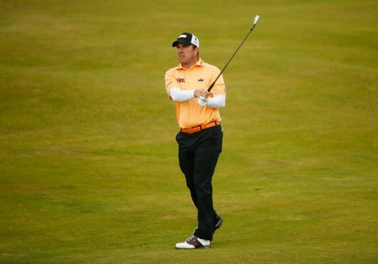 Richie Ramsay hits his second shot on the 8th hole during the second round of the 146th Open at Royal Birkdale.