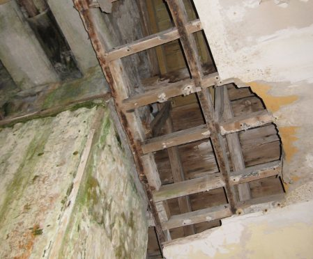 Damage caused to the inside of the church tower by rainwater.