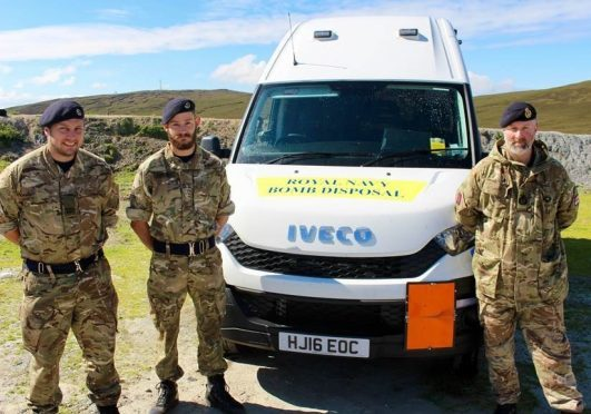 Bomb disposal team officers (left to right) 'Sticky' Cunningham, Jon Robinson and Garth Spence