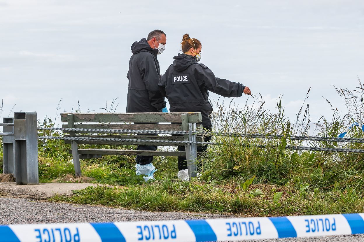 Forensic officers search the scene at Land Street in Buckpool.