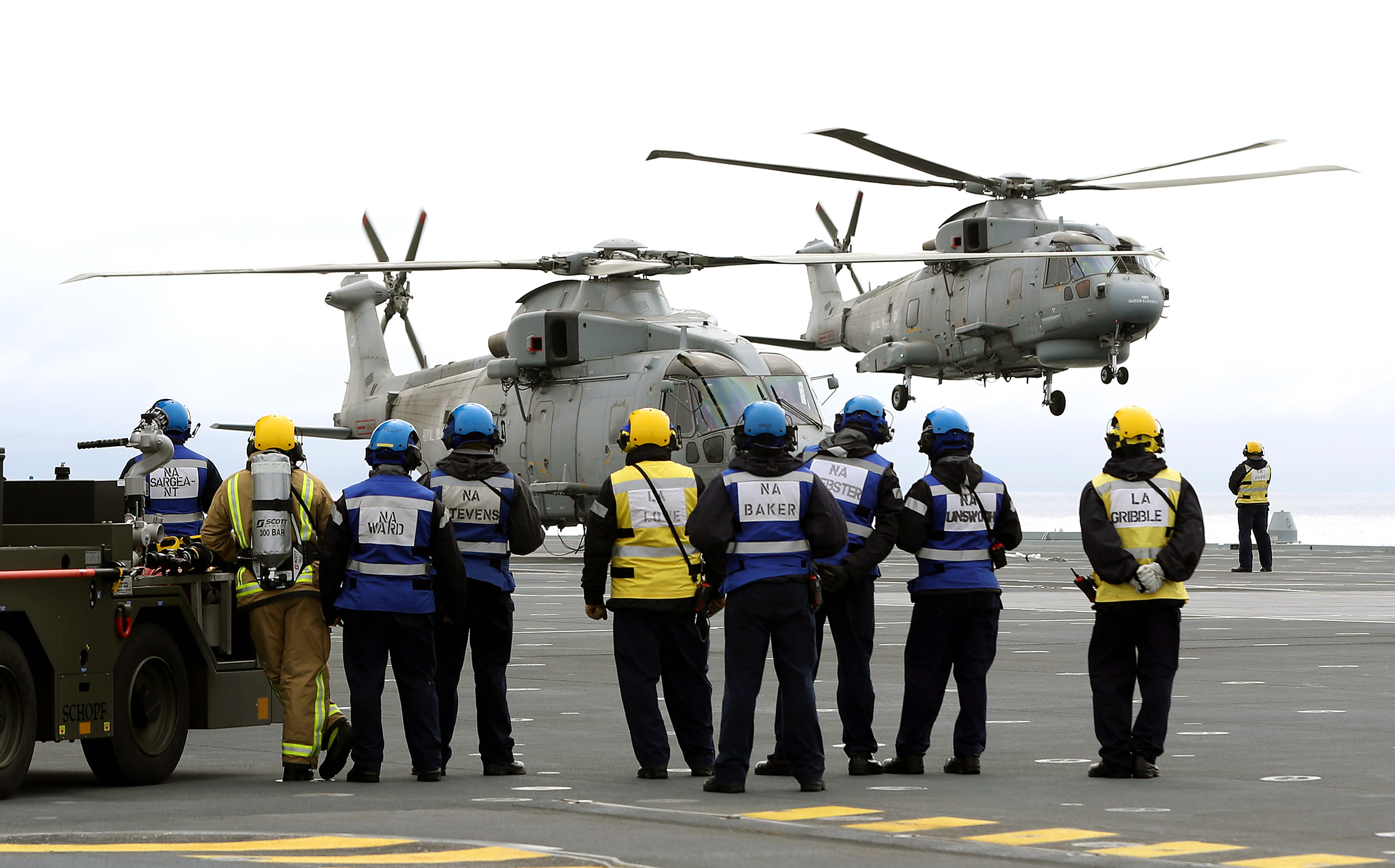 The Defence Secretary landed by Merlin helicopter on the deck of the new aircraft carrier HMS Queen Elizabeth, which is currently on sea trials off the coast of Scotland. He met with members of the crew and thanked them for their contribution to UK defence. While addressing the Ship's Company, Sir Michael announced the Britain's second aircraft carrier, HMS Prince of Wales, will be officially named at a ceremony in Rosyth on 8th September 2017.  He arrived in a Merlin helicopter from 820 Naval Air Squadron.  He was briefed on the progress of the ships contractor sea trials and he then addressed the ships company on the flight deck.