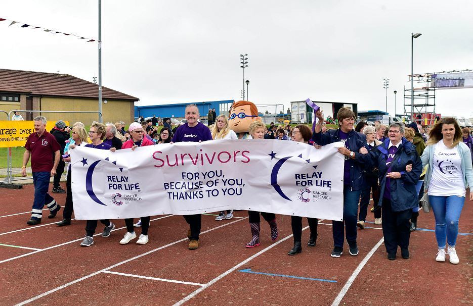 Survivors get the Relay for Life 2017 underway.