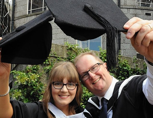 Father and daughter graduates Chloe and Billy Jackson.